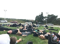 "Participants engaging in a ""die-in"" in memory of those who have died without health care coverage"